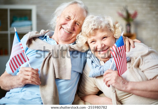 Smiling seniors with American flags