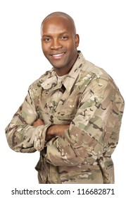 Smiling serviceman with his arms crossed