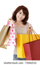Smiling shopping woman of Asian, closeup portrait of young lady holding bags on white background.