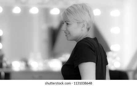 Smiling short haircut woman with piercing in her nose