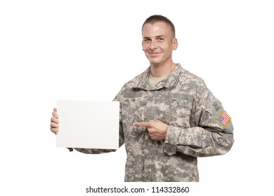 Smiling soldier points to a blank sign