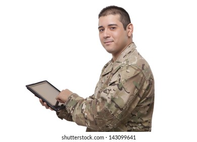 smiling soldier working on a digital tablet
