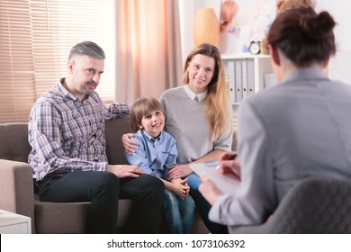 Smiling son with his happy parents during a consultation with advisor