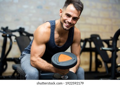 smiling sportsman looking at camera