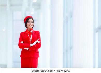 Smiling stewardess at airport