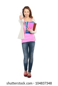 A smiling student girl with books and thumb up sign, isolated on white