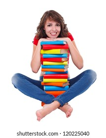 Smiling student girl with plenty of books over white background