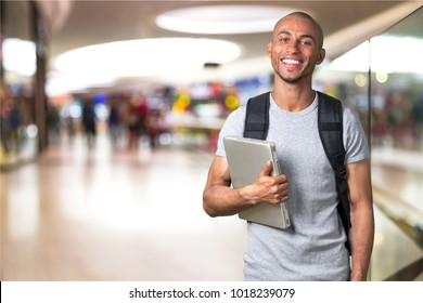 Smiling student man with laptop