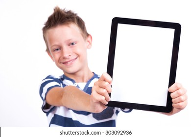 smiling student with a tablet in his hand screen to the client on a white background shows the application photo with depth of field