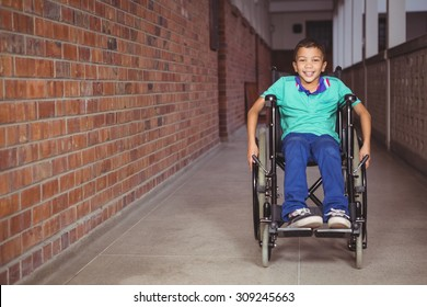 Smiling student in a wheelchair on the elementary school grounds