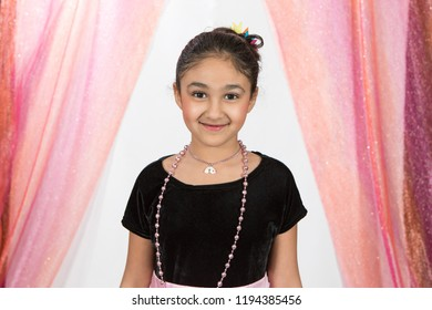 Smiling Studio Portrait of a Little Girl Playing Dress Up