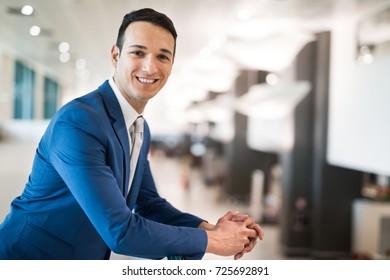 Smiling successful businessman portrait