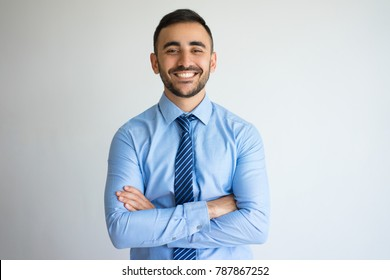 Smiling Successful Young Leader with Arms Crossed