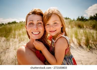 smiling summertime family on the beach