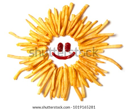 Smiling sun with rays. French fries in the form of the and a face with a smile from ketchup isolated on white background