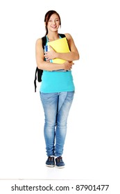 Smiling teen caucasian girl with backpack holding her notes. Isolated on white.