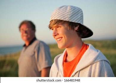 Smiling teen with father out on a hike