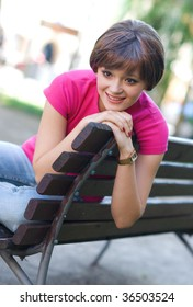 smiling teen girl on the park bench