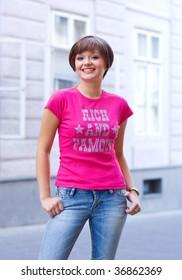 smiling teen girl on the street