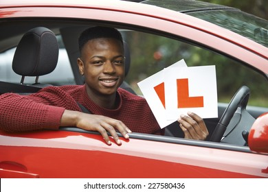 Smiling Teenage Boy In Car Passing Driving Exam