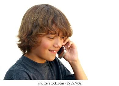 Smiling teenage boy talking on mobile phone isolated on white background.