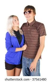 Smiling teenage couple. Isolated over white.