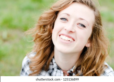 Smiling teenage girl had shot portrait