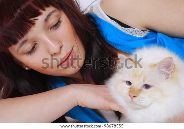 smiling teenage girl with her birman cat