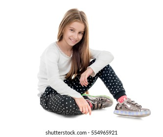 smiling teenage girl sitting on the floor, isolated on white background