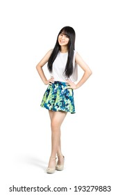 Smiling teenager asian girl standing, Isolated over white