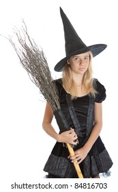 smiling teenager girl in Halloween witch with broom