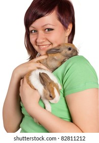 Smiling teenager girl with her brown bunny rabbit