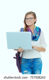 Smiling teenager with laptop on white background. Student.