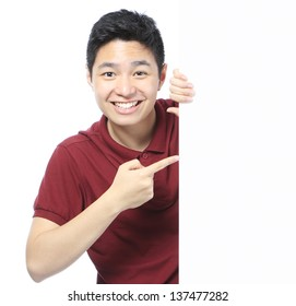 A smiling teenager pointing at an empty space