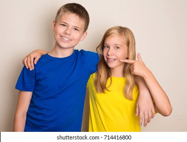 Smiling teens with different kinds of dental brace showing  thumb up gesture. Healthcare health and people concept.