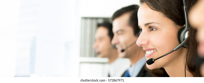Smiling telemarketing customer service agents, call center job concept, web banner with copy space