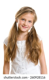 Smiling ten year old girl isolated on white.