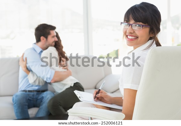 Smiling Therapist Patients Hugging Behind Her Stock Photo
