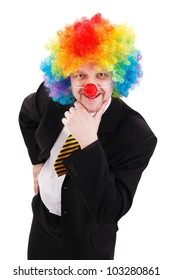 Smiling and thinking business man, wearing colorful clown wig
