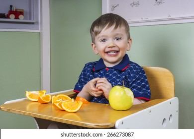 Smiling toddler eating fruit