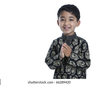 Smiling Toddler with Folded Hands Signifying Traditional Indian Greeting, Namaste, Isolated, White