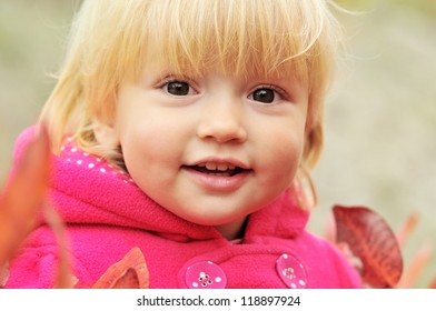 smiling toddler girl in fall time