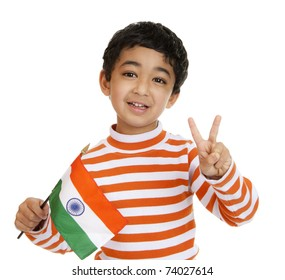 Smiling Toddler Holds a Flag of India and Flashes Victory Sign, Isolated, White