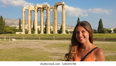 Smiling tourist woman with the greek temple of Olympian Zeus on the background, Athens, Greece. Panoramic banner crop.