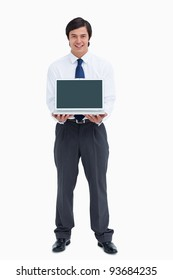 Smiling tradesman presenting screen of his laptop against a white background