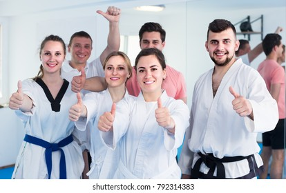 smiling trainees expressing interest in attending karate class