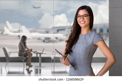 Smiling traveling corporate executive portrait, business person at the airport terminal