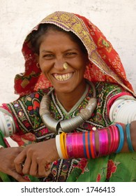 a smiling tribal woman in a village in india