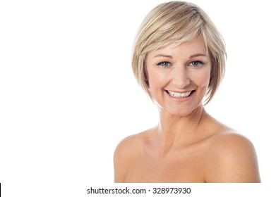 Smiling unclad lady posing over white