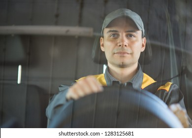 Smiling van or truck driver on the road